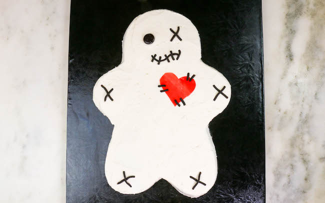 Voodoo Doll Cake with Licorice Pieces and Fruit Roll Up Heart | Erin Bakes