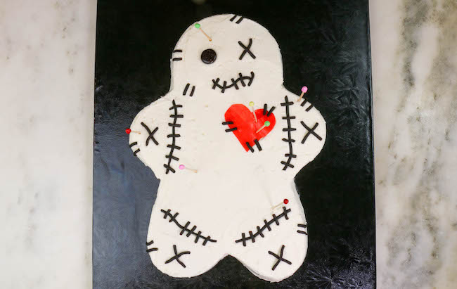 Adding the Toothpick Pins to the Voodoo Doll Cake | Erin Bakes