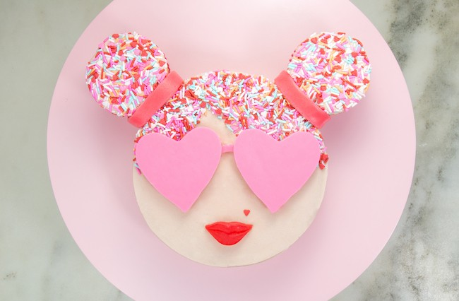Round cake finished with buttercream, sprinkle hair, and heart-shaped pink chocolate sunglasses | Erin Gardner | Erin Bakes
